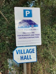 parking sign - free parking at the hall for residents visitors and contractors
